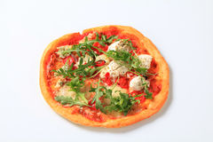 Pizza quattro formaggi with arugula Stock Image