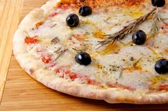 Pizza quattro formaggi 4 cheese on a wooden board. Oven baked pizza quattro formaggi 4 cheese on a wooden board Stock Photos
