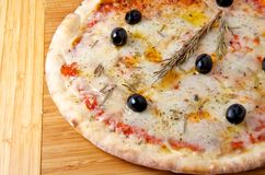 Pizza quattro formaggi 4 cheese on a wooden board. Oven baked pizza quattro formaggi 4 cheese on a wooden board Stock Images