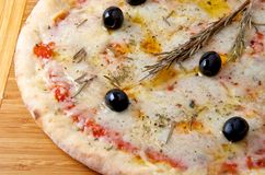 Pizza quattro formaggi 4 cheese on a wooden board. Oven baked pizza quattro formaggi 4 cheese on a wooden board Royalty Free Stock Photo
