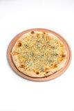 Pizza quattro fromaggi on a wooden board stock photos