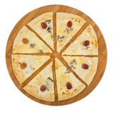 Pizza quattro fromaggi on wooden board. Isolated on white background. Clipping path Stock Images