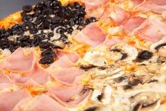 Pizza Quattro Stagioni. Closeup on the center of a Pizza Quattro Stagioni Stock Images