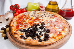 Pizza Quattro Stagioni Stock Photo