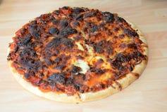 Pizza quemada Imágenes de archivo libres de regalías