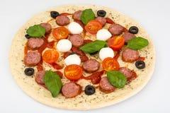 Pizza raw semifinished product before baking stock images