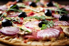 Pizza with red onion and mushrooms. Stock Image