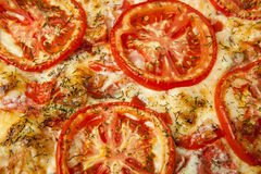 Pizza with red tomato circles. Close-up Royalty Free Stock Images