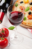 Pizza and red wine Royalty Free Stock Photos