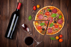 Pizza and red wine Stock Image