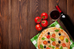 Pizza and red wine Stock Images