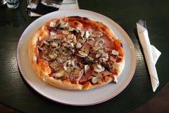 Pizza in Restaurant Stock Image