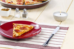 Pizza on restaurant table Stock Images