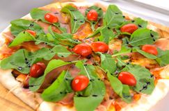 Pizza with rocket salad Stock Image