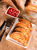 Pizza roll Stock Photography