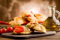 Pizza rolls stuffed with tomato and mozzarella Stock Photography