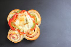 Pizza rolls with vegetables, ham and cheese. Royalty Free Stock Photography