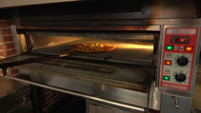 Pizza is rotate in the oven stock video footage