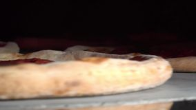 Pizza rotates in the oven. Close up view stock footage