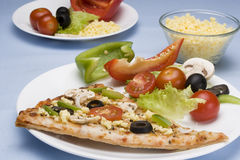 Pizza and salad stock photos