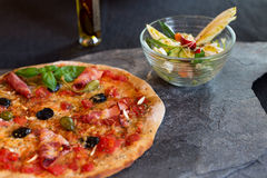 Pizza and salad Stock Photography