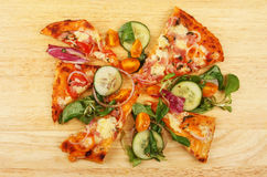 Pizza and salad Stock Image