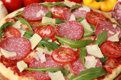 Pizza Salami. Pizza with salami, cheese, tomatoes and lettuce royalty free stock photos