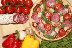 Pizza Salami. Pizza with salami, cheese, tomatoes and lettuce stock photography