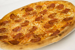 Pizza with salami and cheese. Close up of traditional pizza with salami,cheese and pepperoni,see more in Restaurant food Royalty Free Stock Photos