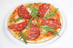 Pizza with salami, cheese and arugula Stock Photo