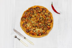 Pizza with salami and cherry tomatoes Royalty Free Stock Images