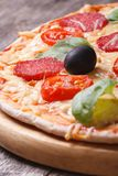 Pizza with salami close-up on the table. vertical Royalty Free Stock Photo