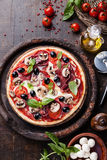 Pizza with salami, mushrooms and olives Stock Image