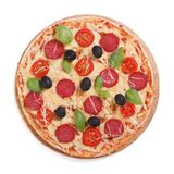 Pizza with salami, olives and basil isolated on white Royalty Free Stock Photography