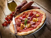 Pizza with salami and pepper Stock Image