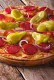 Pizza with salami, pepperoni peppers on table closeup vertical Stock Photography