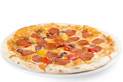 Pizza with salami. Smoked sausage, egg, pepper, cheese and tomato sauce Royalty Free Stock Photo