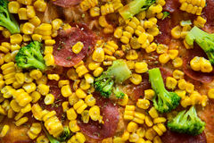 Pizza with salami, sweetcorn and broccoli Stock Photography