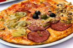 Pizza with Salami, Tomatoes and Chili Pepper Royalty Free Stock Photography