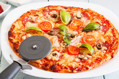 Pizza with salami, tomatoes and olives Royalty Free Stock Photo