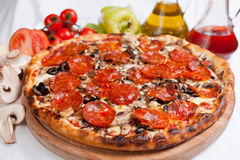 Pizza Salamy. With mushrooms and olive royalty free stock photos