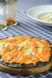 Pizza with salmon Royalty Free Stock Photo