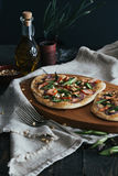 Pizza with salmon, asparagus and pine nuts, aperture 8. Pizza with salmon, asparagus and pine nuts: homemade dough, red onion, fresh cheese with cayenne pepper royalty free stock photos