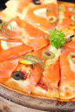 Pizza Salmon piece decorated. Salmon Pizza great Tray is cut into ready to eat Royalty Free Stock Image