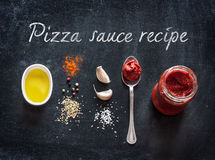 Pizza sauce ingredients on black background Stock Photography