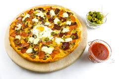Pizza with sauce and olives from above Stock Photos