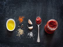 Pizza sauce recipe on black background Stock Photo
