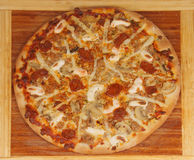 Pizza with sausage. Handmade pizza cooked in wood oven consists of sausage, tuna, mushrooms and a variety of cheeses stock photography