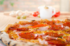 Pizza with sausage, bacon and pepperoni - close up Stock Image