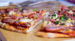 Pizza with sausage, chicken, corn and cheese. Italian cuisine Royalty Free Stock Image